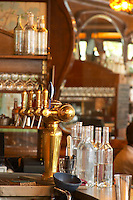 The brass beer and water taps and water carafes in the bar The Bistrot du Peintre is an old fashioned Paris café cafe bar restaurant of art nouveau design with polished brass, mirrors and old signs