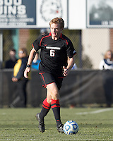 Northeastern University defender Jonathan Eckford (6) looks to pass..NCAA Tournament. University of Connecticut (white) defeated Northeastern University (black), 1-0, at Morrone Stadium at University of Connecticut on November 18, 2012.