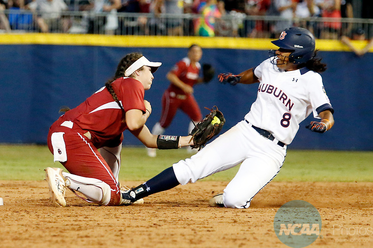 07 JUNE 2016:  Oklahoma infielder Caleigh Clifton (20) tags out Auburn first baseman Jade Rhodes (8) at second base during the Division I Women's Softball Championship is held at ASA Hall of Fame Stadium in Oklahoma City, OK.  Shane Bevel/NCAA Photos