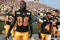 September 7, 2009; Hamilton, ON, CAN; Hamilton Tiger-Cats defensive tackle Matt Kirk (93) defensive end Montez Murphy (98) wide receiver Arland Bruce III (4) quarterback Quinton Porter (12). CFL football - the Labour Day Classic - Toronto Argonauts vs. Hamilton Tiger-Cats at Ivor Wynne Stadium. The Tiger-Cats defeated the Argos 34-15. Mandatory Credit: Ron Scheffler.