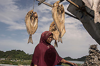 "Indonesia – Sumatra – Aceh – Layuen - 45-year-old fish seller Nurul Hayati complains that ""Before the tsunami I had a big business. I was selling 100 kg of fish per day, now fishermen are scared to go to the open sea and there is no more fish to sell"". ""We are going through hard times, but at least we have a house"" she says, referring to the reconstruction of the village carried out by World Vision. ""It's still better than sleeping under a tree"""