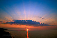 Rays of light, summer solstice sunset, Lake Superior