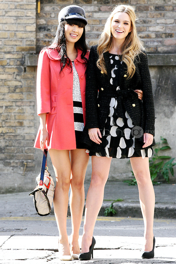 NO REPRO FEE.30/8/2010. AWEAR AUTUMN COLLECTION. Yomiko Chen & Sarah Morrissey model a selection of dresses from A|wear's new autumn '10 collection at Kehoes Pub in Dublin. Sarah wears Monochrome petal shift dress - EUR50 Black coat - EUR80 .Yomiko Chen wears Lace shift dress - EUR40 Coral bow coat - EUR50 Peak cap - EUR15.  The collection arrives instore and onwww.awear.comfrom this week. Picture James Horan/Collins Photos