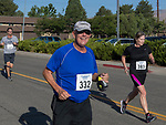 Jim Ohl smiles as he heads towards the finish line during the 49th Annual Journal Jog in Reno, Nevada on Sunday, September 10, 2017.