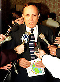 New York City Mayor Rudolph Giuliani holds an impromptu press confrence after his speech at the foster care luncheon at  the Renaissance Hotel in Washington, D.C. on June 26, 1997..Credit: Ron Sachs / CNP