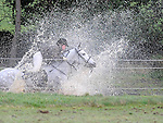 A rider passes through a water jump at Piperstown during the Louth Hunt. Photo: Colin Bell/pressphotos.ie