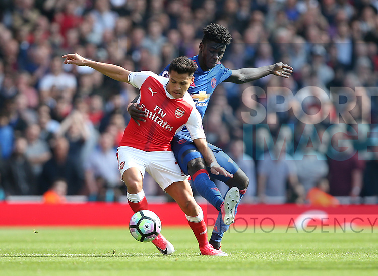 Arsenal's Alexis Sanchez tussles with Manchester United's Axel Tuanzebe during the Premier League match at the Emirates Stadium, London. Picture date: May 7th, 2017. Pic credit should read: David Klein/Sportimage