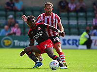 Lincoln City's Neal Eardley vies for possession with Swindon Town's Jermaine McGlashan<br /> <br /> Photographer Andrew Vaughan/CameraSport<br /> <br /> The EFL Sky Bet League Two - Lincoln City v Swindon Town - Saturday August 11th 2018 - Sincil Bank - Lincoln<br /> <br /> World Copyright &copy; 2018 CameraSport. All rights reserved. 43 Linden Ave. Countesthorpe. Leicester. England. LE8 5PG - Tel: +44 (0) 116 277 4147 - admin@camerasport.com - www.camerasport.com