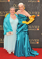 Jamie Campbell and his mother Margaret at the Olivier Awards 2018, Royal Albert Hall, Kensington Gore, London, England, UK, on Sunday 08 April 2018.<br /> CAP/CAN<br /> &copy;CAN/Capital Pictures<br /> CAP/CAN<br /> &copy;CAN/Capital Pictures