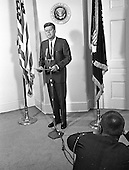 A photographer captures the moment as United States President John F. Kennedy announces the appointment of W. Willard Wirtz as US Secretary of Labor at the White House in Washington, DC on August 30, 1962.<br /> Credit: Arnie Sachs / CNP