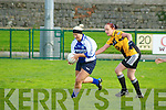 Memorial Game : Garda Helena Carey wins the ball despite the close attention of Helen McCarthy, Listowel Emmets in the Carmel O'Connor Memorial Match fund raising game at Listowel on Saturday last in aid of Listowel Cancer Support Group.