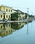 High Water - Old buildings along Bach Dang St reflected in high flood waters of the Thu Bon river, overcast afternoon, Hoi An, Viet Nam