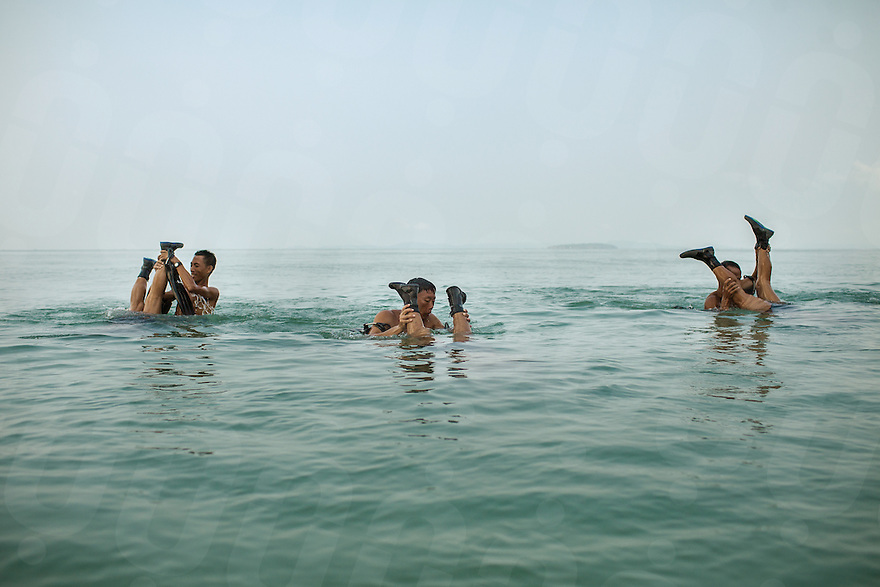 14 February, 2013 - Sihanoukville. A group of deminers from CMAC make exercises in the water of Independence Beach nearby Sihanoukville. © Thomas Cristofoletti / Ruom