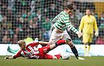 Rory McKenzie tackles Tony Watt