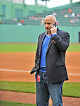 8 June 2012: Washington Nationals General Manager Mike Rizzo chats on his phone and awaits the start of play between the Washington Nationals and the Boston Red Sox at Fenway Park in Boston, MA. The Nationals defeated the Red Sox 7-4 in the opening game of their 3-game series. Mandatory Credit: Ed Wolfstein Photo