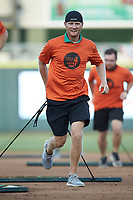 The Augusta GreenJackets grounds crew drags the infield between innings of the South Atlantic League game against the Kannapolis Intimidators at SRG Park on July 6, 2019 in North Augusta, South Carolina. The Intimidators defeated the GreenJackets 9-5. (Brian Westerholt/Four Seam Images)