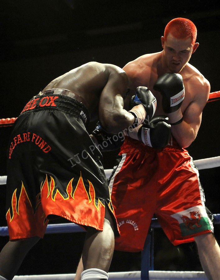 Hari Miles ( Red with Black stripe ) V Nick Okoth (Black flame shorts).Joe Calzaghe Promotions Boxing Evening .Date: Friday 20/11/2009,  .© Ian Cook IJC Photography, 07599826381, iancook@ijcphotography.co.uk,  www.ijcphotography.co.uk, .
