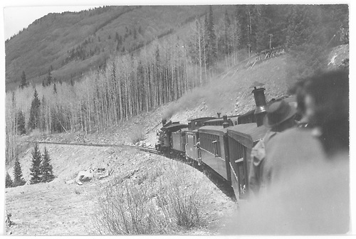 Rocky Club RGS excursion train pulled by leased D&amp;RGW C-18 #319 above Matterhorn on 3rd curve below Trout Lake.<br /> RGS  Matterhorn, CO  Taken by Maxwell, John W. - 5/31/1947