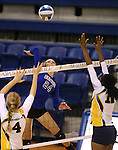 Marymount's Emileigh Rettig hits against St. Mary's during a college volleyball game in Lexington Park, MD, on Wednesday, Oct. 29, 2014. Marymount won 3-2 to go 24-9 on the season.<br />