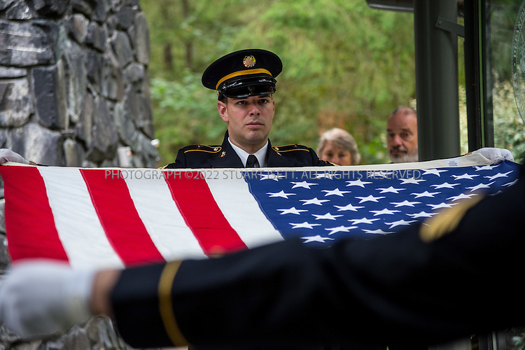 9/30/2016-- Tahoma National Cemetery, Kent, WA, USA<br /> <br /> Here: Flag folding during funeral services placed in a commitment shelter during funerals services at the Tahoma National Cemetery.<br /> <br /> James Lindley, 34, an undertaker and US Marine Corp Veteran, works at the Columbia Funeral Home in Seattle, Washington and has taken it upon himself to process the remains of indigent veterans and ensure their remains are placed in Tahoma National Cemetery in nearby Kent, WASH. The veterans are given full military funerals with active service members as well as volunteers who stand-in for unavailable next-of-kin, accepting the folded flags provided by the Veterans Administration.<br /> <br /> On this day, with the help of Mr. Lindley, the remains of 4 veterans were interred at the Tahoma National Cemetery: <br /> <br /> Richard Fesler, born 1951, died 2014. US Army Veteran<br /> Rocky Stallone, born 1951, died 2014. Marine Corps veteran<br /> Russell Ristow, born 1944, died 2014. US Army veteran.<br /> Wayne Roberts, Born 1937, died 2014. US Navy veteran.<br /> <br /> <br /> Credit: Stuart Isett for The Wall Street Journal. <br /> VETBODIES<br /> <br /> &copy;2016 Stuart Isett. All rights reserved.