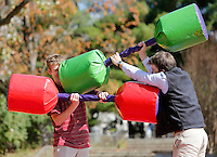 NWA Democrat-Gazette/DAVID GOTTSCHALK  Cole Smith (left) and Aidan Holobowicz (cq), both freshman at the University of Arkansas, battle each other Wednesday, October 4, 2015, in an inflatable jousting pit on campus during the Fight for the Kids event sponsored by Hogs for Hope. The activity was one of several events this week sponsored by the student organization that raises funds for Arkansas Children's Hospital.