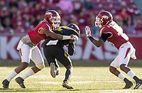 Hawgs Illustrated/BEN GOFF <br /> Henre' Toliver (5), Arkansas cornerback, and Kevin Richardson, Arkansas nickel back, tackle J'Mon Moore, Missouri wide receiver, in the second quarter Friday, Nov. 24, 2017, at Reynolds Razorback Stadium in Fayetteville.