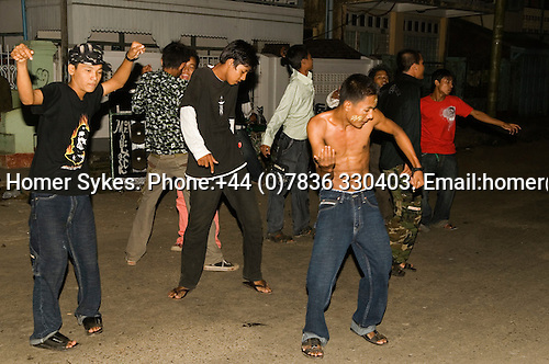 Sittwe Northern Rakhaing province Myanmar (Burma) 2008. Full Moon festival. teens dance to modern rock music on the streets.