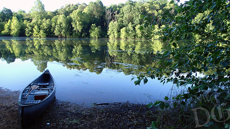 NWA Democrat-Gazette/FLIP PUTTHOFF <br />Sunrise is ideal for fishing Lake Hindsville by canoe or kayak. The lake is seen here in early June during a trip for black bass, but bluegill turned out to be the prize June 16 2017 on a second visit to the little lake.