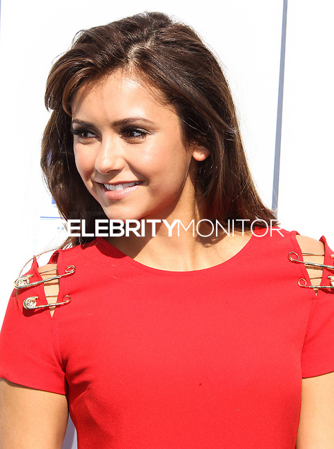 UNIVERSAL CITY, CA - JULY 27: Nina Dobrev attends Variety's Power of Youth presented by Hasbro and GenerationOn at Universal Studios Backlot on July 27, 2013 in Universal City, California. (Photo by Celebrity Monitor)