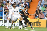 02.09.2012 SPAIN -  La Liga 12/13 Matchday 3th  match played between Real Madrid CF vs  Granada C.F. (3-0) at Santiago Bernabeu stadium. The picture show Alvaro Arbeloa Coca (Spanish defender of Real Madrid) and Fabian Ariel Orellana (Chile Midfielder of Granada C.F.)