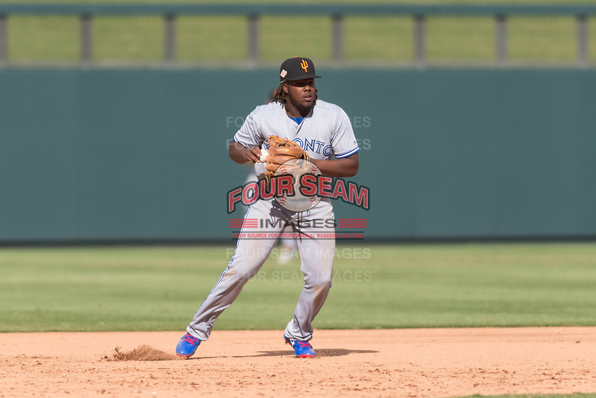 Surprise Saguaros third baseman Vladimir Guerrero Jr. (27), of the Toronto Blue Jays organization, prepares to make a throw to first base during an Arizona Fall League game against the Salt River Rafters at Salt River Fields at Talking Stick on October 23, 2018 in Scottsdale, Arizona. Salt River defeated Surprise 7-5 . (Zachary Lucy/Four Seam Images)