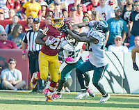 Washington Redskins running back Matt Jones (31) eludes the tackle of Philadelphia Eagles cornerback Nolan Carroll (22) in fourth quarter action at FedEx Field in Landover, Maryland on Sunday, October 16, 2016.<br /> The Redskins won the game 27 - 20.<br /> Credit: Ron Sachs / CNP /MediaPunch