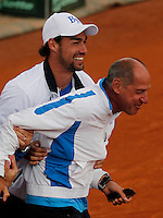 Italy's Fabio Fognini  and Corrado Barazzutti celebrate  after winning    Davis Cup quarter-final tennis match against Britainy and qualify for semifinal  in Naples April 6, 2014.