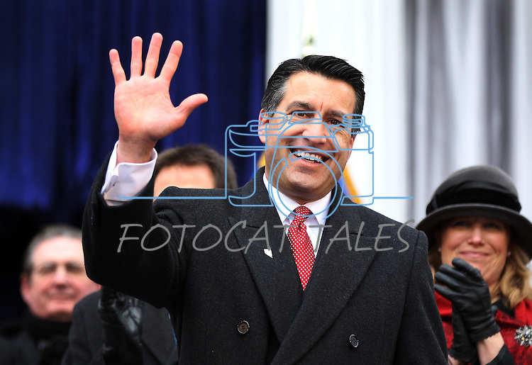 Nevada Gov. Brian Sandoval waves to the crowd following Monday's inauguration ceremony, Jan. 3, 2011 at the Capitol in Carson City, Nev. <br /> Photo by Cathleen Allison