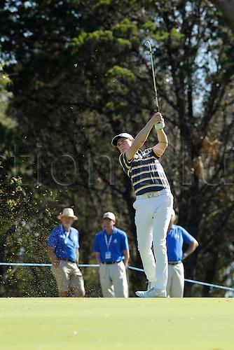 26.02.2016. Perth, Australia. ISPS HANDA Perth International Golf. Todd Sinnott (AUS) plays an approach shot on the 18th fairway during day 2.