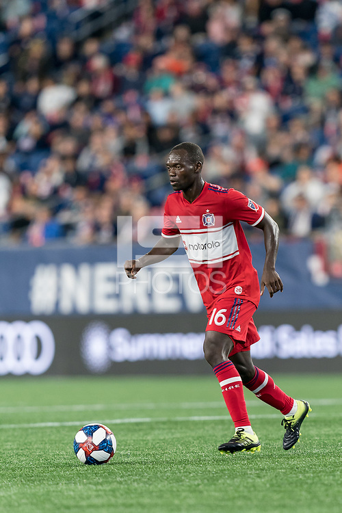 FOXBOROUGH, MA - AUGUST 25: Micheal Azira #16 of Chicago Fire dribbles at midfield during a game between Chicago Fire and New England Revolution at Gillette Stadium on August 24, 2019 in Foxborough, Massachusetts.
