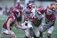NWA Democrat-Gazette/J.T. WAMPLER Arkansas wide receiver La'Michael Pittway gets stopped by Reid Miller (from left) Josh Harris and Dwayne Eugene Saturday April 29, 2017 during a red-white scrimmage. The scheduled practice was closed to the general public and moved indoors because of thunderstorms.