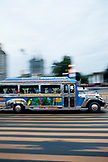 PHILIPPINES, Manila, transportation bus drives down Rojas Blvd by the Bay Walk