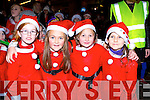 Orla O'Sullivan, Ella Doyle, Marie O'Leary and Ella O'Donnell having fun at the arrival of Santa to Killorglin on Sunday evening