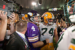 Minnesota Vikings quarterback Brett Favre (4) meets former teammate Green Bay Packers defensive lineman Aaron Kampman (74) after an NFL football game at the Hubert H. Humphrey Metrodome on October 5, 2009 in Minneapolis, Minnesota. The Vikings won 30-23. (AP Photo/David Stluka)
