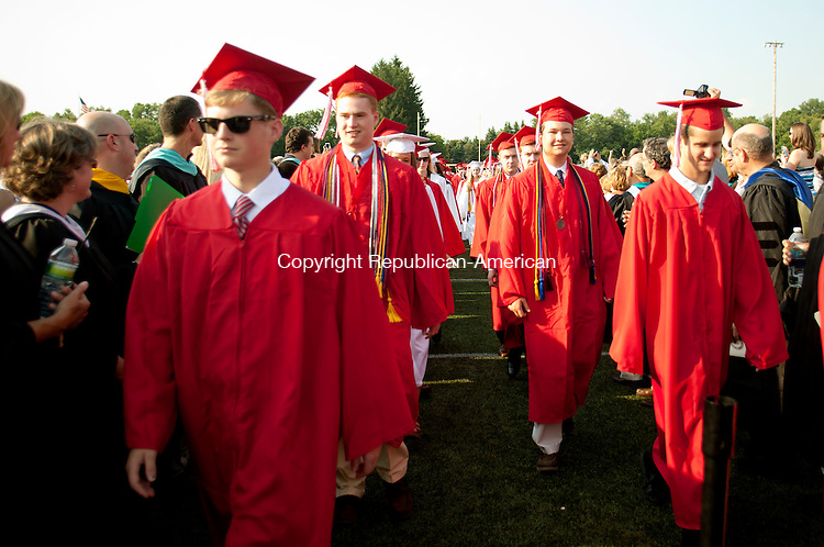 WATERBURY, CT-21 June 2013-062113BF08-  Graduates proceed onto the football field Friday during graduation at Cheshire High School in Cheshire. Bob Falcetti Republican-American