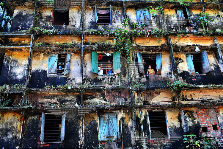 The decrepit front of an ancient house home to 80 families of road sweepers.