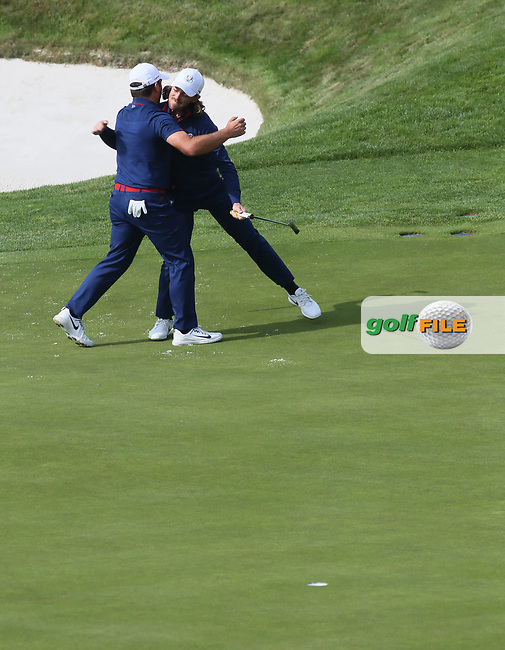 Tommy Fleetwood (Team Europe) and Francesco Molinari (Team Europe) celebrate a birdie on the 16th during Friday's Fourballs, at the Ryder Cup, Le Golf National, Îls-de-France, France. 28/09/2018.<br /> Picture David Lloyd / Golffile.ie<br /> <br /> All photo usage must carry mandatory copyright credit (© Golffile | David Lloyd)