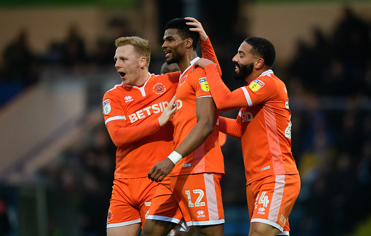 Blackpool's Michael Nottingham, centre, celebrates scoring his side's equalising goal to make the score 1-1 with team-mate Callum Guy, left, and Liam Feeney<br /> <br /> Photographer Chris Vaughan/CameraSport<br /> <br /> The EFL Sky Bet League One - Rochdale v Blackpool - Wednesday 26th December 2018 - Spotland Stadium - Rochdale<br /> <br /> World Copyright © 2018 CameraSport. All rights reserved. 43 Linden Ave. Countesthorpe. Leicester. England. LE8 5PG - Tel: +44 (0) 116 277 4147 - admin@camerasport.com - www.camerasport.com