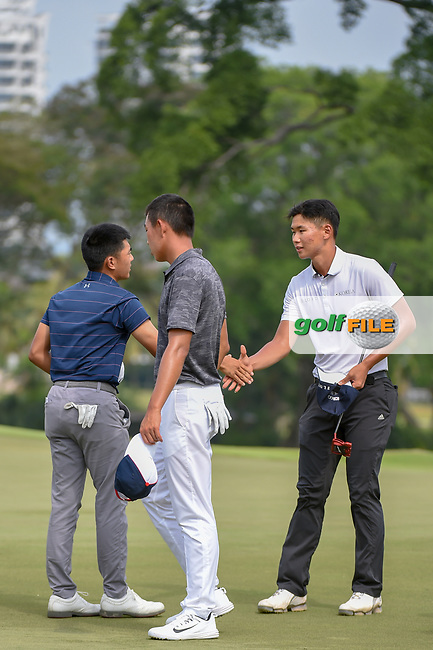 Lloyd Jefferson GO (PHI) shakes hands with Jin-Bo HA (KOR) following Rd 3 of the Asia-Pacific Amateur Championship, Sentosa Golf Club, Singapore. 10/6/2018.<br /> Picture: Golffile | Ken Murray<br /> <br /> <br /> All photo usage must carry mandatory copyright credit (© Golffile | Ken Murray)