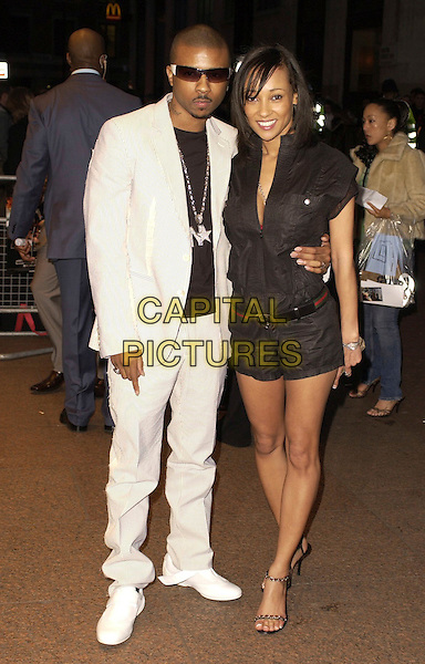 """LISA MAFIA & GUEST.""""Rollin' With The Nines"""" - UK premiere at the Odeon Leicester Square, London, UK..April 19th, 2006.Ref: CAN.full length black top shorts white suit.www.capitalpictures.com.sales@capitalpictures.com.©Capital Pictures"""
