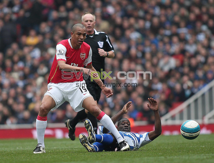 PICTURE BY JEREMY RATA/SWPIX.COM - Barclays Premier League Football - Arsenal v Reading - Emirates Stadium, London, England - 19/04/08. Arsenals Gilberto is tackled by Readings Kalifa Cisse ..Copyright - Simon Wilkinson - 07811267706..