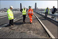 BNPS.co.uk (01202 558833)<br /> Pix: Sally Adams/BNPS<br /> <br /> Bemused officials study the damaged bridge surface in February 2012<br /> <br /> Road to nowhere...Britain's worst bridge has closed yet again, and red faced council can only promise it will reopen in 'mid Autumn'.<br /> <br /> Bridge of sighs - A £37million bridge which has endured a litany of mishaps is now out of action again - until the mid-Autumn.<br /> <br /> The Twin Sails Bridge in Poole, Dorset, which is currently stuck in an upright position, has been plagued by numerous technical faults since it was unveiled amid much fanfare in 2012.<br /> <br /> It was previously out of action in November and December of last year, and for two weeks in February. <br /> <br /> The latest closure is a further blow to locals as the Sandbanks Ferry, which covers a 250ft stretch of water between Sandbanks and Studland, has been shut since July and will not run again until October - forcing motorists to make a 25 mile detour.<br /> <br /> It has sparked outrage on social media, with some labelling it an 'expensive white elephant'.