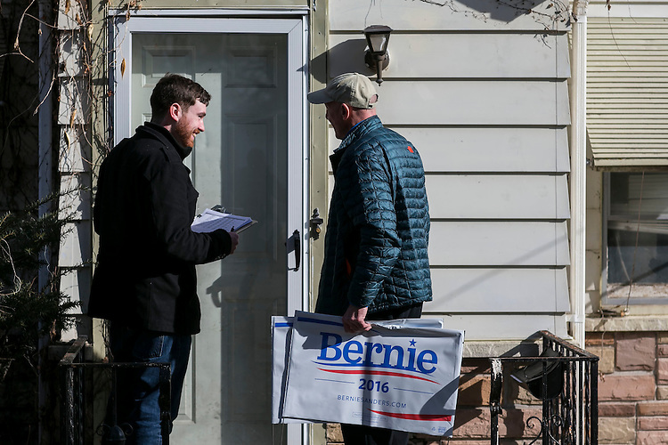 UNITED STATES - FEB 2. - Ryan Hurley, from Regina, Saskatchewan, Canada, who works with Member of Parliament Erin Weir, and Roger Zagar, of Des Moines, knock on a door as they canvass the Union Park neighborhood,  Monday, Feb. 1, 2016 in Des Moines, Iowa. (Photo By Al Drago/CQ Roll Call)