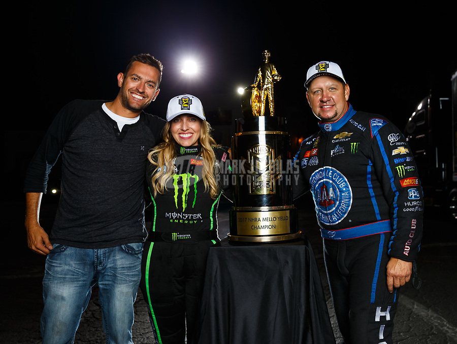 Nov 12, 2017; Pomona, CA, USA; NHRA funny car driver Robert Hight (right) poses for a portrait with top fuel teammate Brittany Force (center) and photographer Mark Rebilas after both clinched the 2017 world championships in their classes during the Auto Club Finals at Auto Club Raceway at Pomona. Mandatory Credit: Mark J. Rebilas-USA TODAY Sports